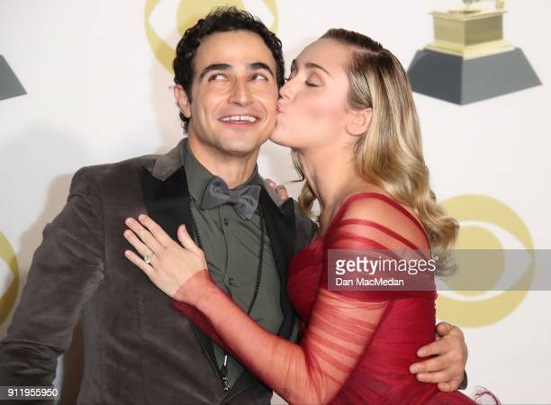 Fashion designer Zac Posen and singer Miley Cyrus pose in the press room at the 60th Annual GRAMMY Awards at Madison Square Garden on January 28 2018...
