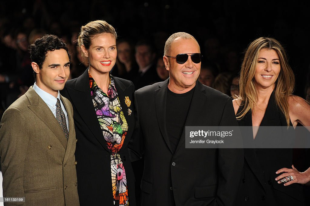 Fashion designer Zac Posen, Model Actress Heidi Klum, Fashion Designer Michael Kors and Fashion editor Nina Garcia on the runway at the Project Runway Fall 2013 fashion show during Mercedes-Benz Fashion Week held at The Theatre at Lincoln Center on February 8, 2013 in New York City.