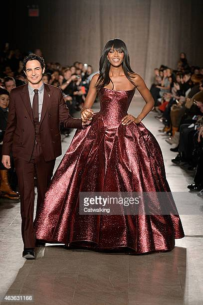 Fashion designer Zac Posen walks the runway with Supermodel Naomi Campbell at the Zac Posen Autumn Winter 2015 fashion show during New York Fashion...