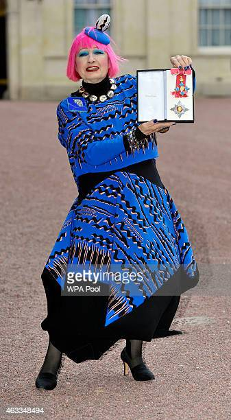 Fashion designer Zandra Rhodes holds her Dame Commander of the Order of the British Empire medal presented to her by the Princess Royal at an...