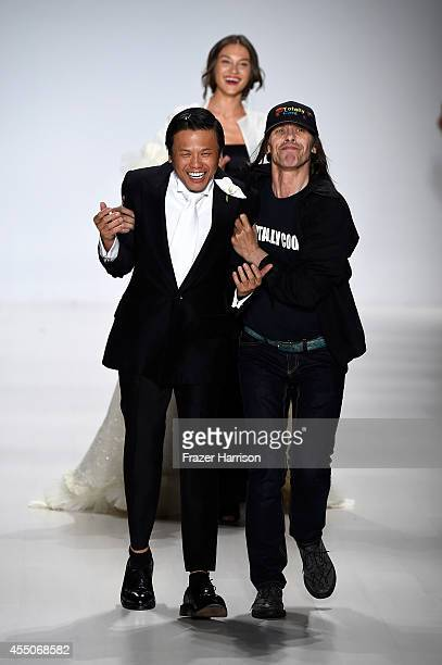 Fashion designer Zang Toi walks the runway at the Zang Toi fashion show during MercedesBenz Fashion Week Spring 2015 at The Salon at Lincoln Center...