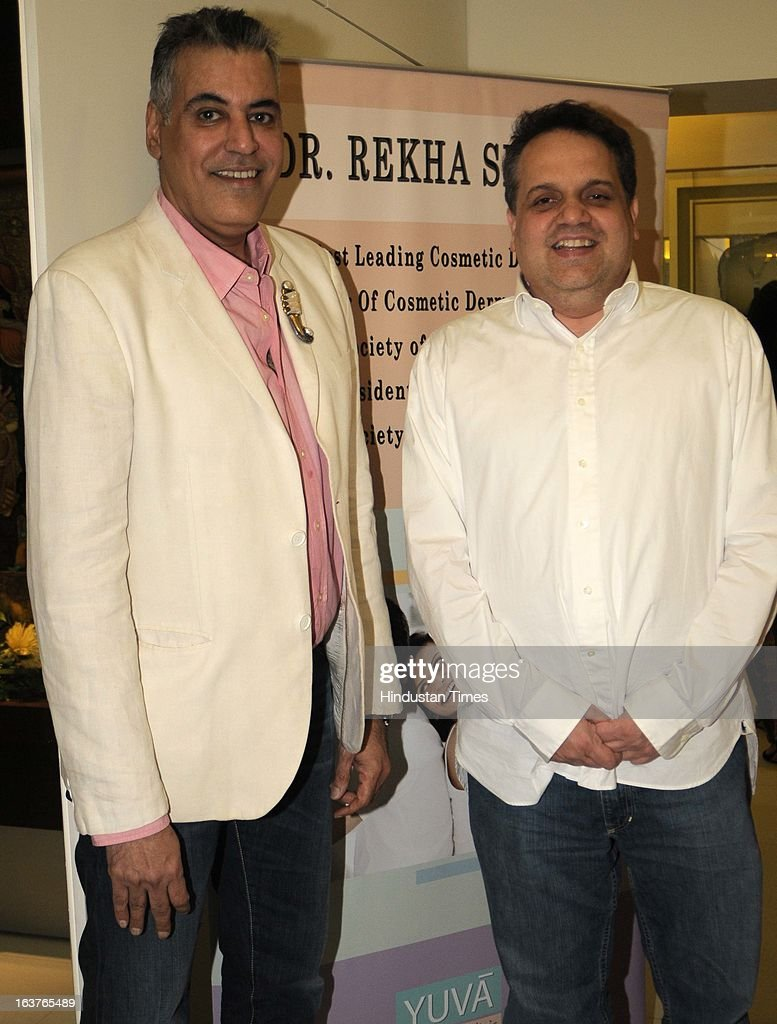 Fashion designers Abu Jani and Sandeep Khosla pose during the celebration of Rekha Seth`s Maria Duran Lectureship award at Juhu on March 13 2013 in...