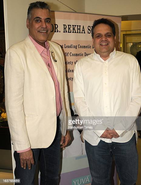 Fashion designers Abu Jani and Sandeep Khosla pose during the celebration of Rekha Seth's Maria Duran Lectureship award at Juhu on March 13 2013 in...