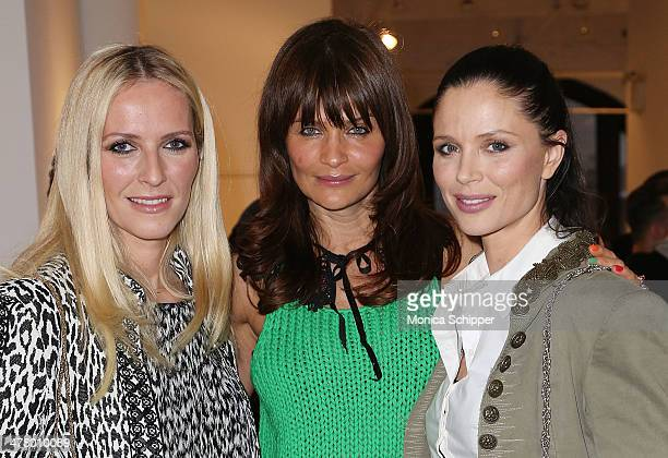 Fashion designers and cofounders of Marchesa Keren Craig and Georgina Chapman and model Helena Christensen attend Vs/Better Charity Art Exhibition...