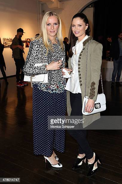 Fashion designers and cofounders of Marchesa Keren Craig and Georgina Chapman attend Vs/Better Charity Art Exhibition opening reception at Dillon...
