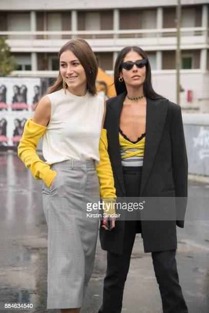 Fashion designers and Founders of fashion label Attico Giorgia Tordini wearing a Calvin Klein top and skirt and Loewe earrings with Gilda Ambroisio...
