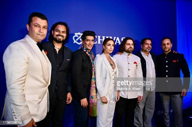 Fashion designers Ashish N Soni Rahul Mishra and Manish Malhotra and Malaika Arora jewelry designer Siddharth Kasliwal artist Sudarshan Shetty and...