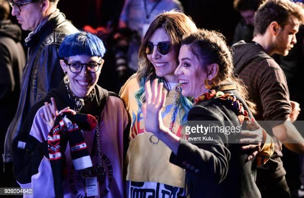 Fashion designers Begum Berdan Deniz Berdan and Billur Saatci attends the DB Berdan show during Mercedes Benz Fashion Week Istanbul at Zorlu Center...