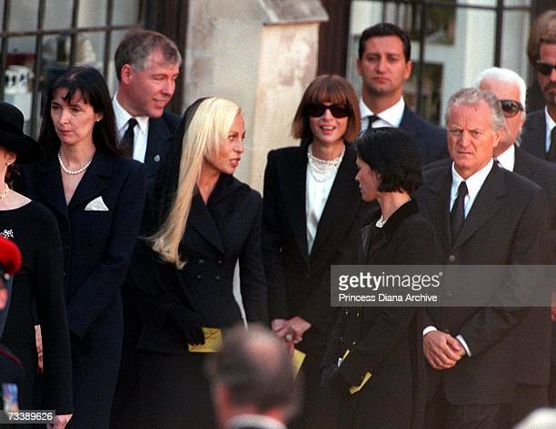 Fashion designers Catherine Walker left and Donatella Versace with her brother Santos Versace American Vogue editor Anna Wintour and Karl Lagerfeld...