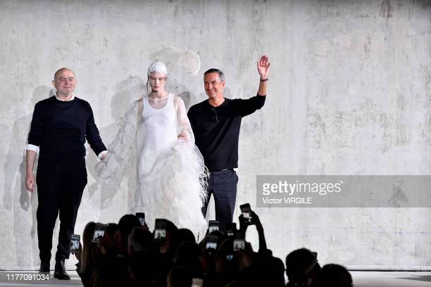 Fashion designers Christian Lacroix and Dries Van Noten walk the runway during the Dries Van Noten ready to Wear Spring/Summer 2020 fashion show as...