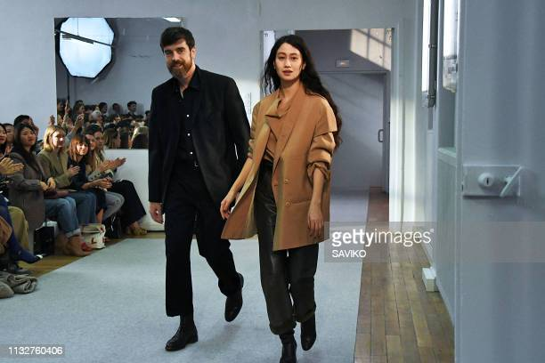 Fashion designers Christophe Lemaire and Sarah-Linh Tran walk the runway at the Lemaire Ready to Wear fashion show during Paris Fashion Week...