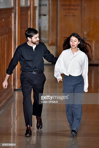 Fashion designers Christophe Lemaire and SarahLinh Tran walk the runway during the Lemaire Menswear Fall/Winter 20162017 show as part of Paris...