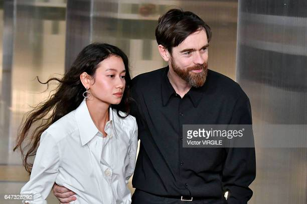 Fashion designers Christophe Lemaire and SarahLinh Tran walk the runway during the Lemaire Ready to Wear fashion show as part of the Paris Fashion...