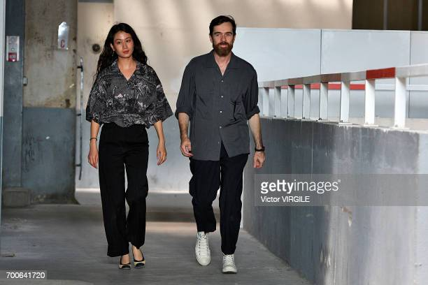 Fashion designers Christophe Lemaire and Sarah-Linh Tran walk the runway during the Lemaire Menswear Spring/Summer 2018 show as part of Paris Fashion...