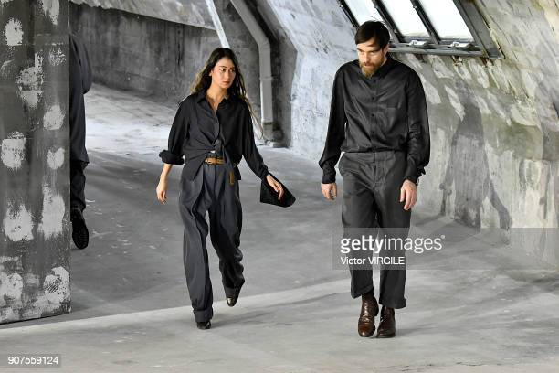 Fashion designers Christophe Lemaire and Sarah-Linh Tran walk the runway during the Lemaire Menswear Fall/Winter 2018-2019 show as part of Paris...