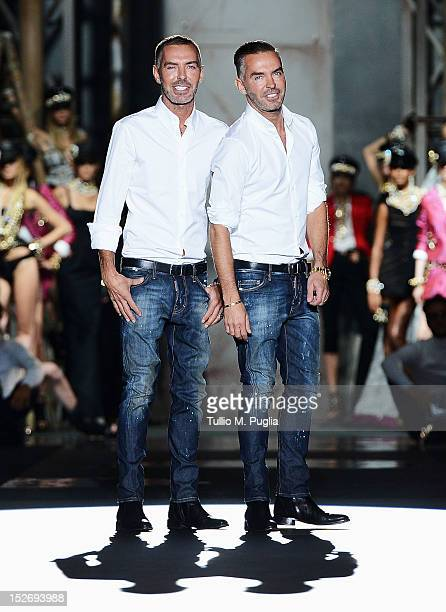 Fashion designers Dan Caten and Dean Caten on the runway after the DSquared2 Spring/Summer 2013 fashion show as part of Milan Womenswear Fashion Week...