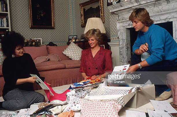 Fashion Designers David & Elizabeth Emanuel With Princess Diana In Her Sitting Room At Kensington Palace Choosing Outfits For A Forthcoming Royal Tour