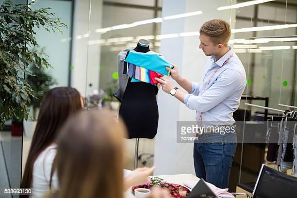 Fashion designers deciding on pattern