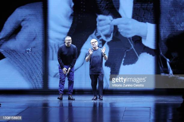 Fashion designers Domenico Dolce and Stefano Gabbana acknowledge the applause of the audience during the Dolce e Gabbana fashion show as part of...