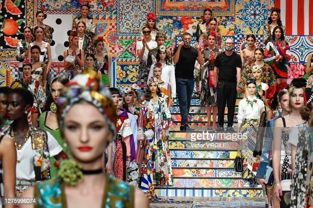 Fashion designers Domenico Dolce and Stefano Gabbana walk the runway at the Dolce Gabbana Ready to Wear Spring/Summer 2021 fashion show during the...