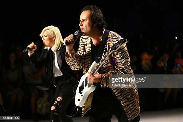 Fashion designers Estel Day and Mark Tango perform on the runway during the Mark And Estel fashion show during MercedesBenz Fashion Week Spring 2015...
