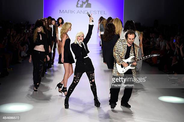 Fashion designers Estel Day and Mark Tango pose on the runway at the Mark And Estel fashion show during MercedesBenz Fashion Week Spring 2015 at The...