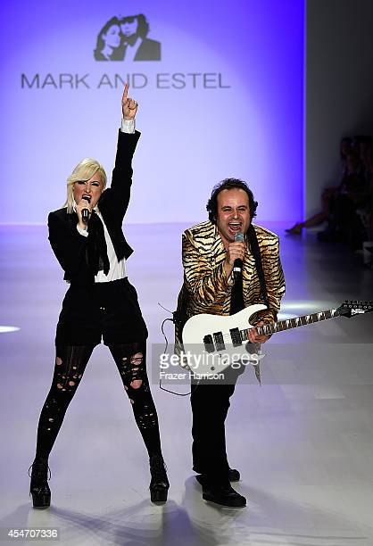 Fashion designers Estel Day and Mark Tango pose on the runway at the Mark And Estel fashion show during Mercedes-Benz Fashion Week Spring 2015 at The...