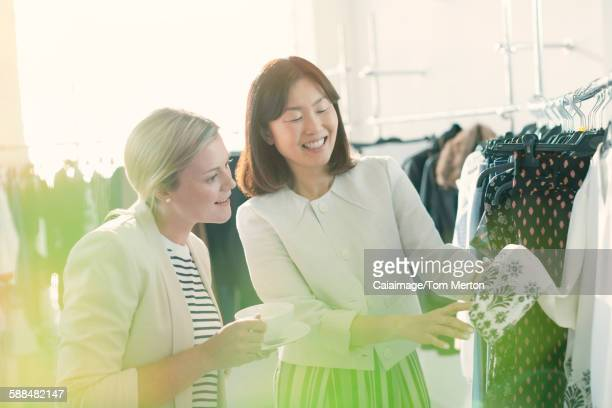 Fashion designers examining cuff detail on blouse