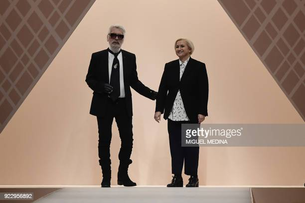 Fashion designers for Fendi Karl Lagerfeld and Silvia Venturini Fendi acknowledge the audience at the end of the women's Fall/Winter 2018/2019...