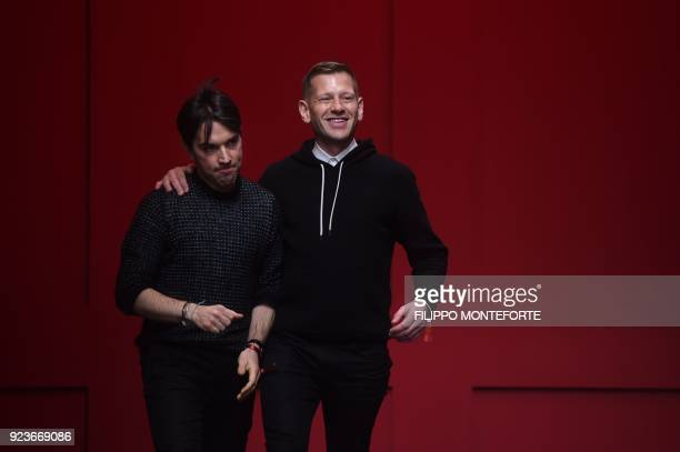 Fashion designers for Salvatore Ferragamo Guillaume Meilland and Paul Andrew acknowledge the audience at the end of the women's Fall/Winter 2018/2019...