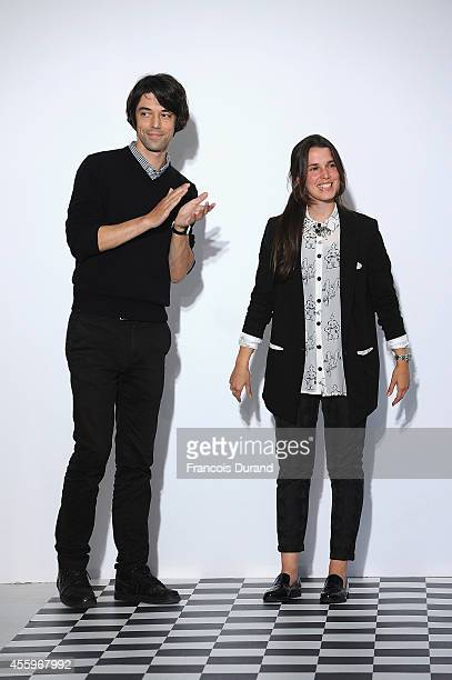 Fashion designers Francois Alary and Ophelie Klere acknowledge the applause of the audience after the Devastee show as part of the Paris Fashion Week...