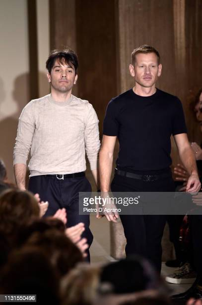 Fashion designers Guillaume Meilland and Paul Andrew acknowledge the audience at the end of the Salvatore Ferragamo show at Milan Fashion Week...