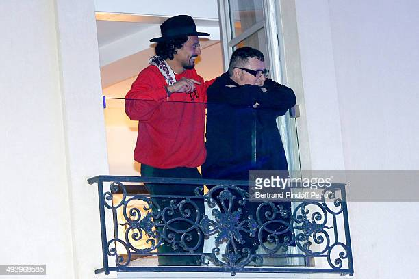 Fashion designers Haider Ackermann and Alber Elbaz attend the Private Concert at Galerie Perrotin in Paris on May 26 2014 in Paris France