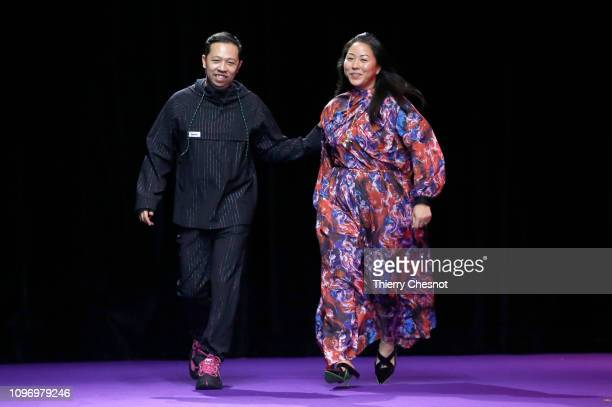 Fashion designers Humberto Leon and Carol Lim acknowledge the audience at the end of the Kenzo Menswear Fall/Winter 20192020 show as part of Paris...
