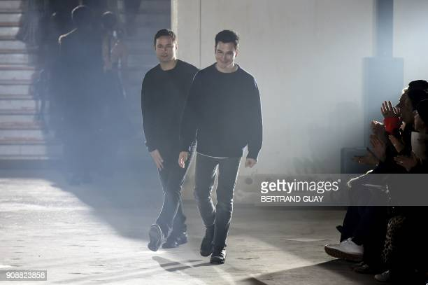 US fashion designers Jack McCollough and Lazaro Hernandez for Proenza Schouler acknowledge the audience at the end of the 2018 spring/summer Haute...