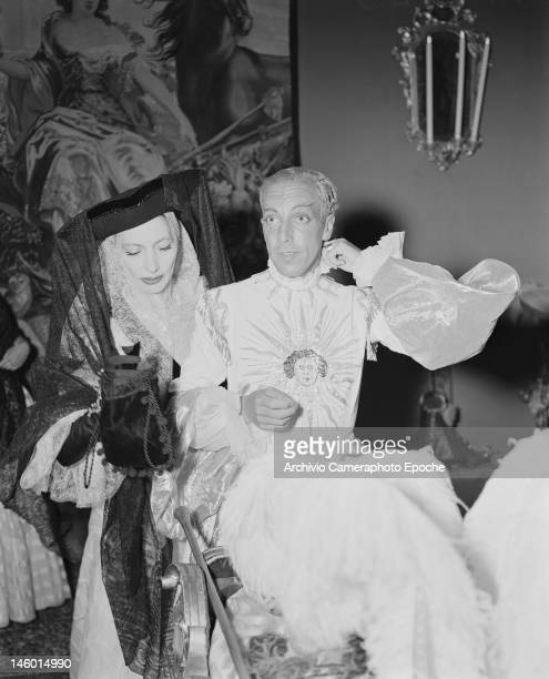Fashion designers Jacques Fath and Valentina Schlee at a masked costume ball at the Palazzo Labia Venice 3rd September 1951 They are dressed as The...