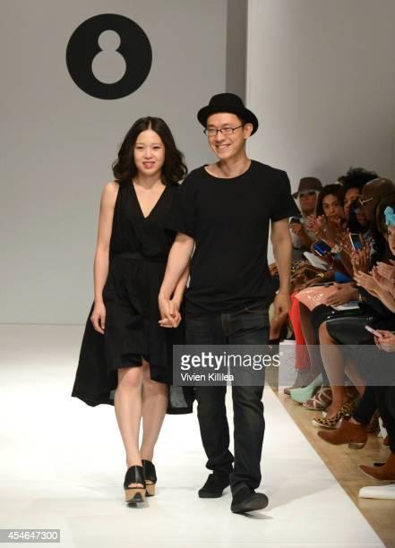 Fashion designers Jennifer and Baekkyu Suh walk the runway at the Snowman fashion show during MercedesBenz Fashion Week Spring 2015 at the Helen...