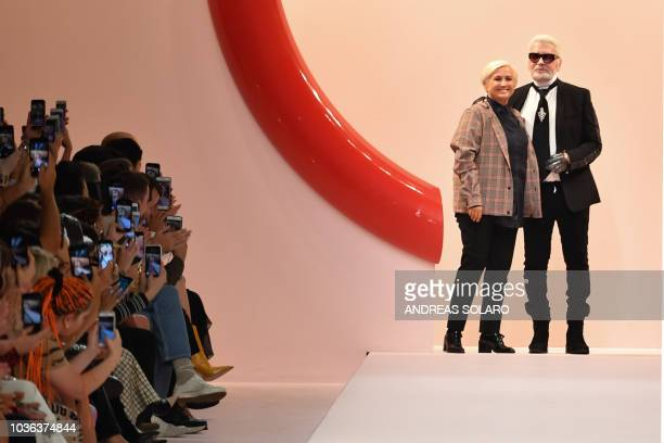 Fashion designers Karl Lagerfeld and Silvia Venturini Fendi acknowledge applause following the presentation of the Fendi fashion collection during...