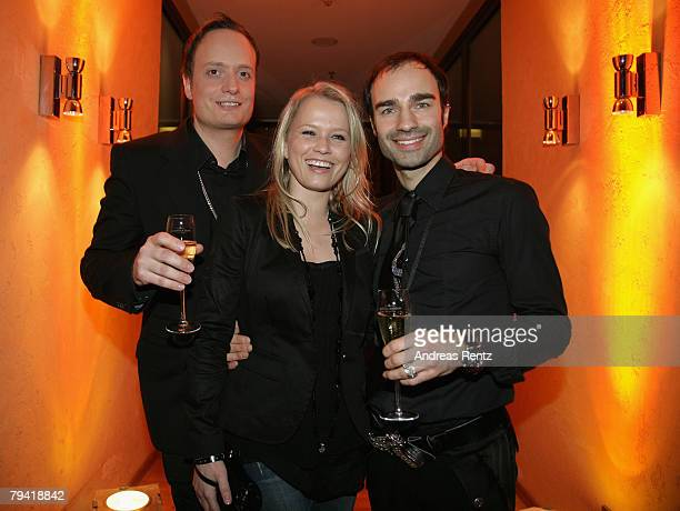Fashion designers Klaus Unrath and Ivan Strano with Nova Meierhenrich attend the after show party to the Unrath Strano fashion show during the...