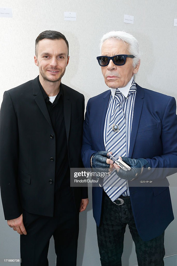 Fashion designers Kris Van Assche and Karl Lagerfeld backstage after Dior Homme Menswear Spring/Summer 2014 Show as part of the Paris Fashion Week on June 29, 2013 in Paris, France.