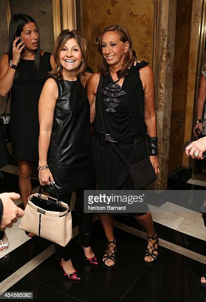 Fashion designers Lisa Perry and Donna Karan attend the New York Times Vanessa Friedman and Alexandra Jacobs welcome party on September 3 2014 in New...