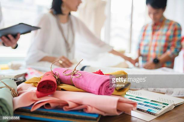 Fashion designers looking at fabric samples