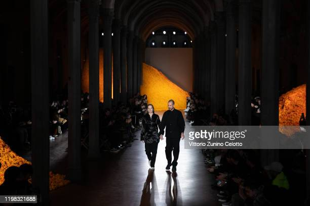 Fashion designers Lucie Meier and Luke Meier walk the runway at the Jil Sander fashion show during Pitti Immagine Uomo 97 at Fortezza Da Basso on...
