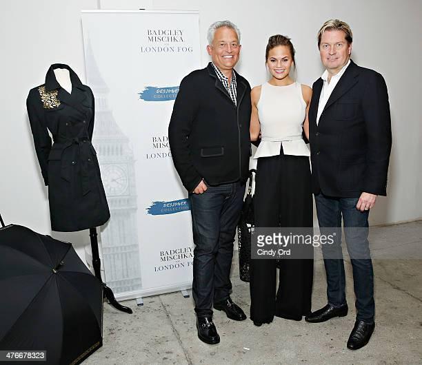 Fashion designers Mark Badgley and James Mischka pose with model Chrissy Teigen as Chrissy Teigen hosts the London Fog Designer Collection...