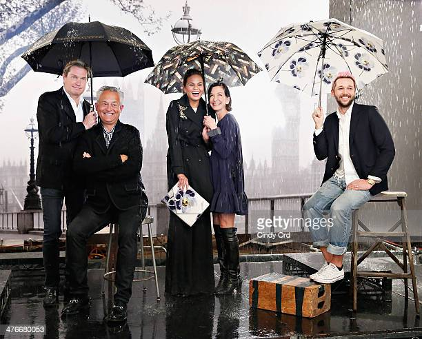 Fashion designers Mark Badgley James Mischka Cynthia Rowley and Chris Benz participate in a photo shoot with model Chrissy Teigen as Chrissy Teigen...