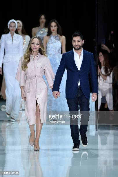 Fashion designers Michael Russo and Tamara Ralph acknowledge the audience at the Ralph Russo Spring Summer 2018 show as part of Paris Fashion Week on...