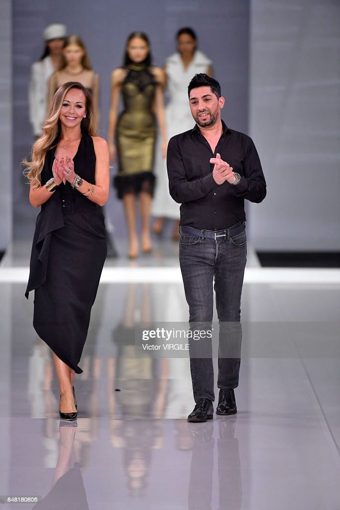 Fashion designers Michael Russo and Tamara Ralph walk the runway at the Ralph & Russo Ready to Wear Spring/Summer 2018 fashion show during London Fashion Week September 2017 on September 15, 2017 in London, England.