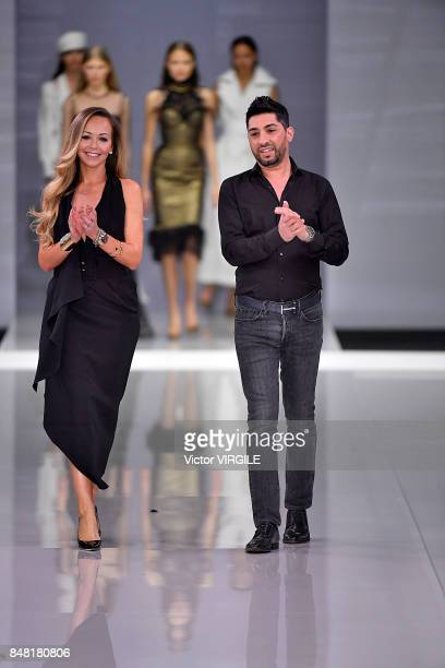 Fashion designers Michael Russo and Tamara Ralph walk the runway at the Ralph Russo Ready to Wear Spring/Summer 2018 fashion show during London...