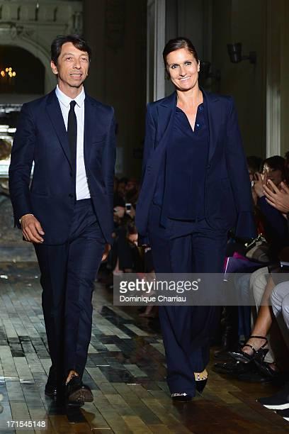 Fashion designers Pier Paolo Piccioli and Maria Grazia Chiuri acknowledge applause following the Valentino Menswear Spring/Summer 2014 show as Part...