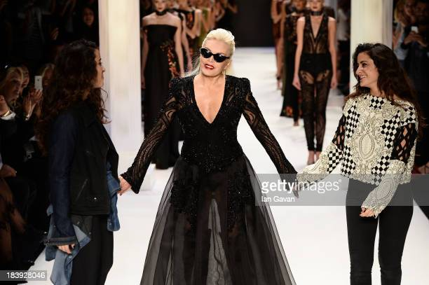 Fashion designers Raisa Sason Vanessa Sason and actress Ajda Pekkan walk the runway at the RaisaVanessa Sason show during MercedesBenz Fashion Week...